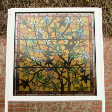 Transparent window film (1) with stained glass print