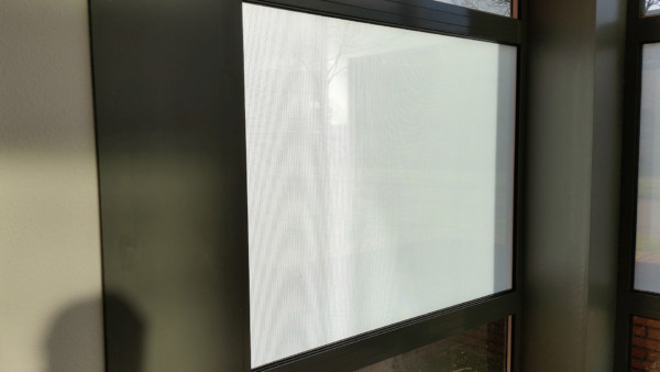perforated window film, applied inside, without print, increase privacy, closeup