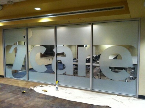 Frosted window film cut (1), large, text, logo, in, frosted, film, on, glass