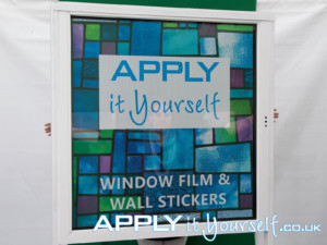 One way vision, window film, front, person close to window