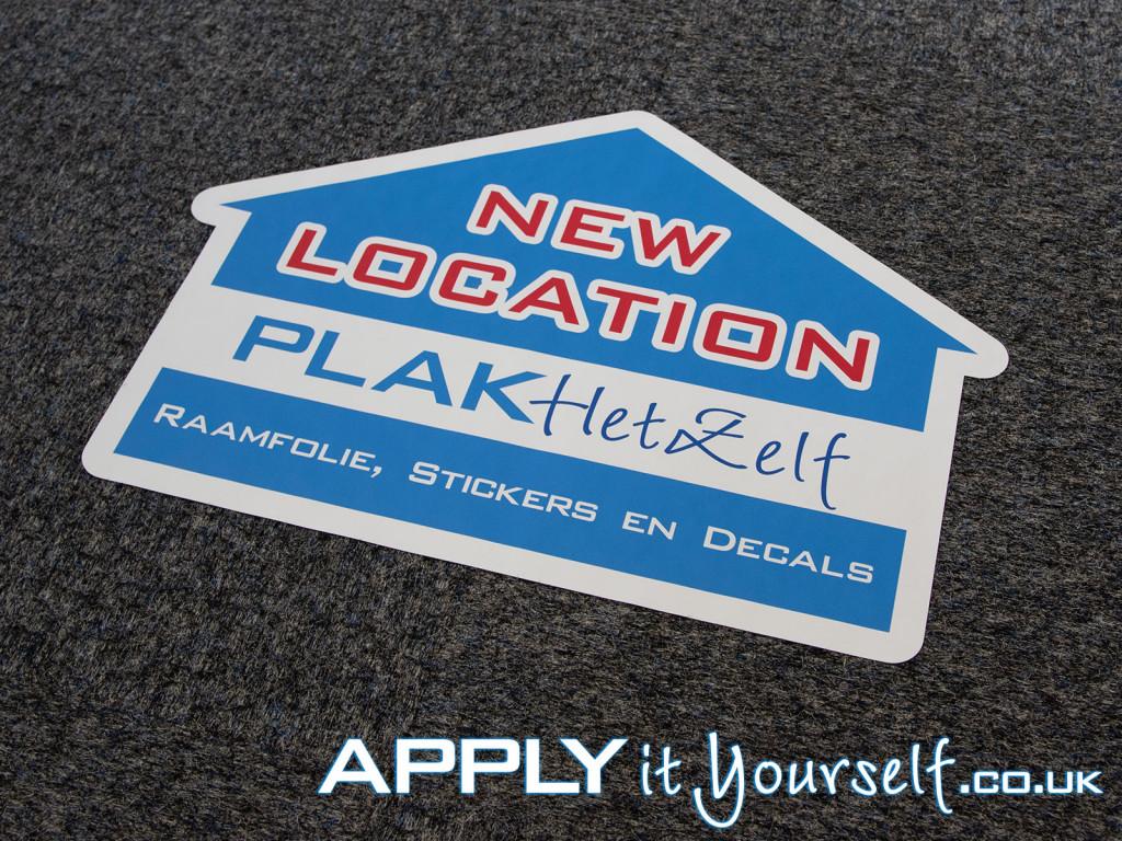 floor graphic, logo, carpet, new store location
